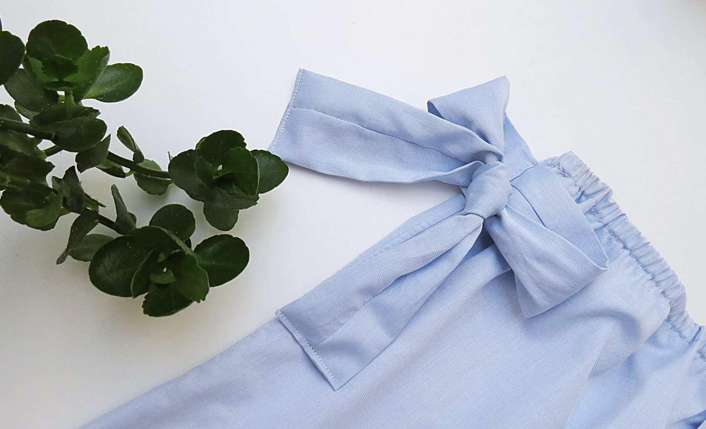 DIY off shoulder shirt ties around arms bow detail